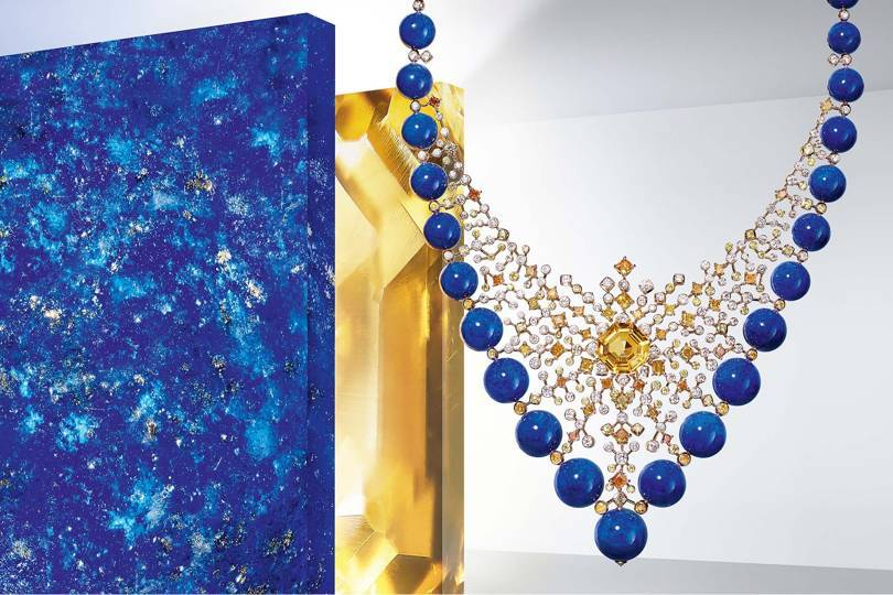 For this Équinoxe necklace from the Magnitude collection, Cartiers lacy openwork constellation consists of a nebula of yellow-orange and white diamonds, orange-toned yellow sapphire, and lapis lazuli
