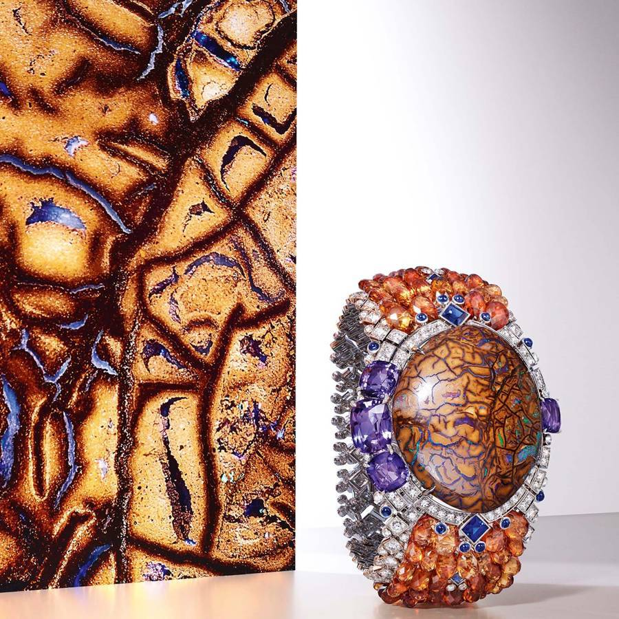 Credit: Cartiers Zemia bracelet from the Magnitude collection has a 77.27-carat matrix-opal centre, surrounded by blue and purple sapphires, garnets, and diamonds