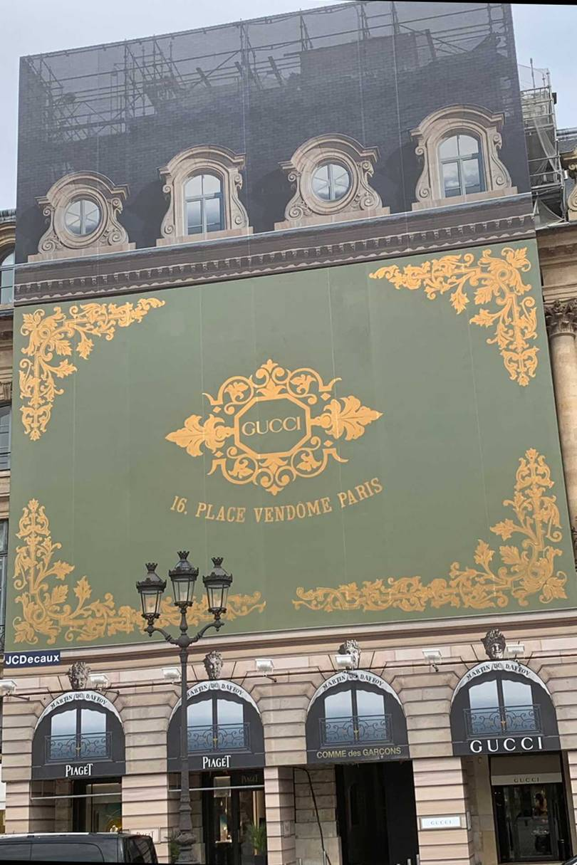 The giant Gucci advertising hoarding in Place Vendôme, announcing the arrival of the new Gucci bijoux boutique, which opened in July