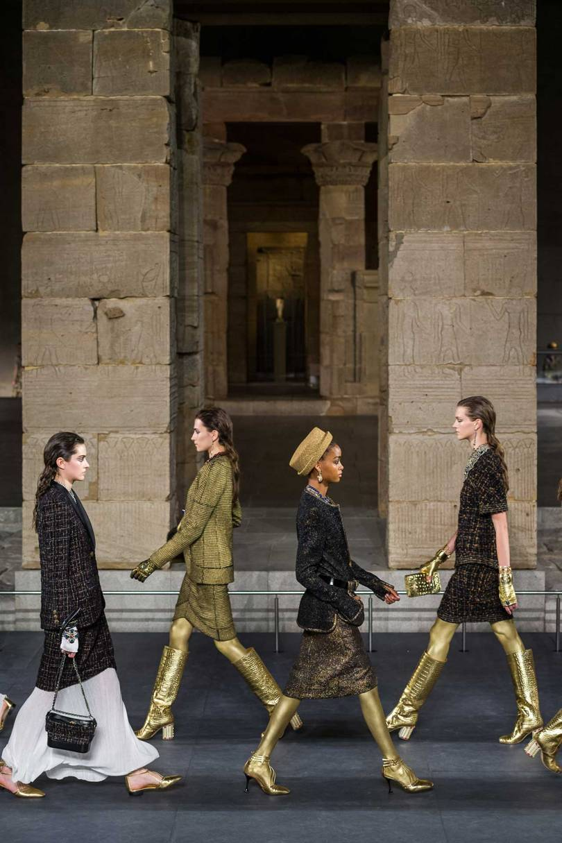 Chanels models parade past the Temple of Dendur at the Metropolitan Museum of Art in New York. Credit: GORUNWAY