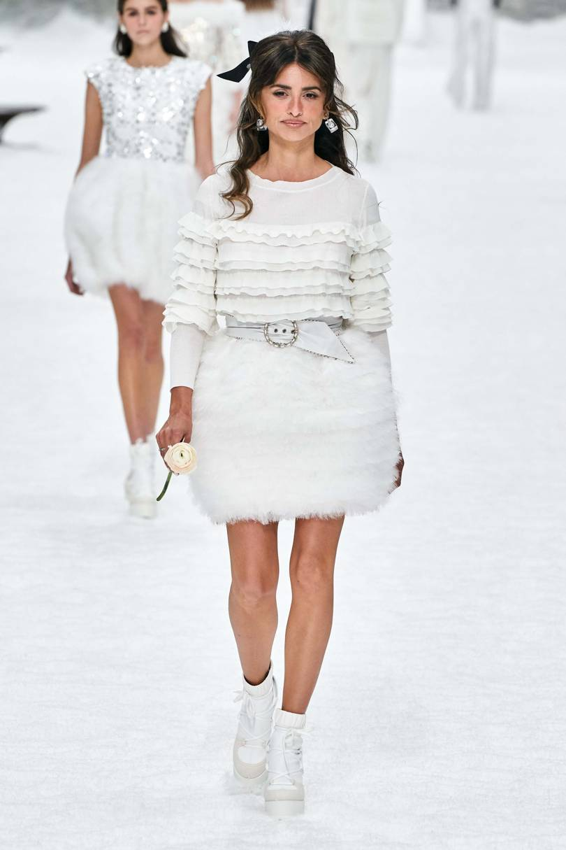 Penelope Cruz took to the runway in a skirt shaped like a snowball and gripping a white rose Credt: ALESSANDRO LUCIONI / GORUNWAY.COM