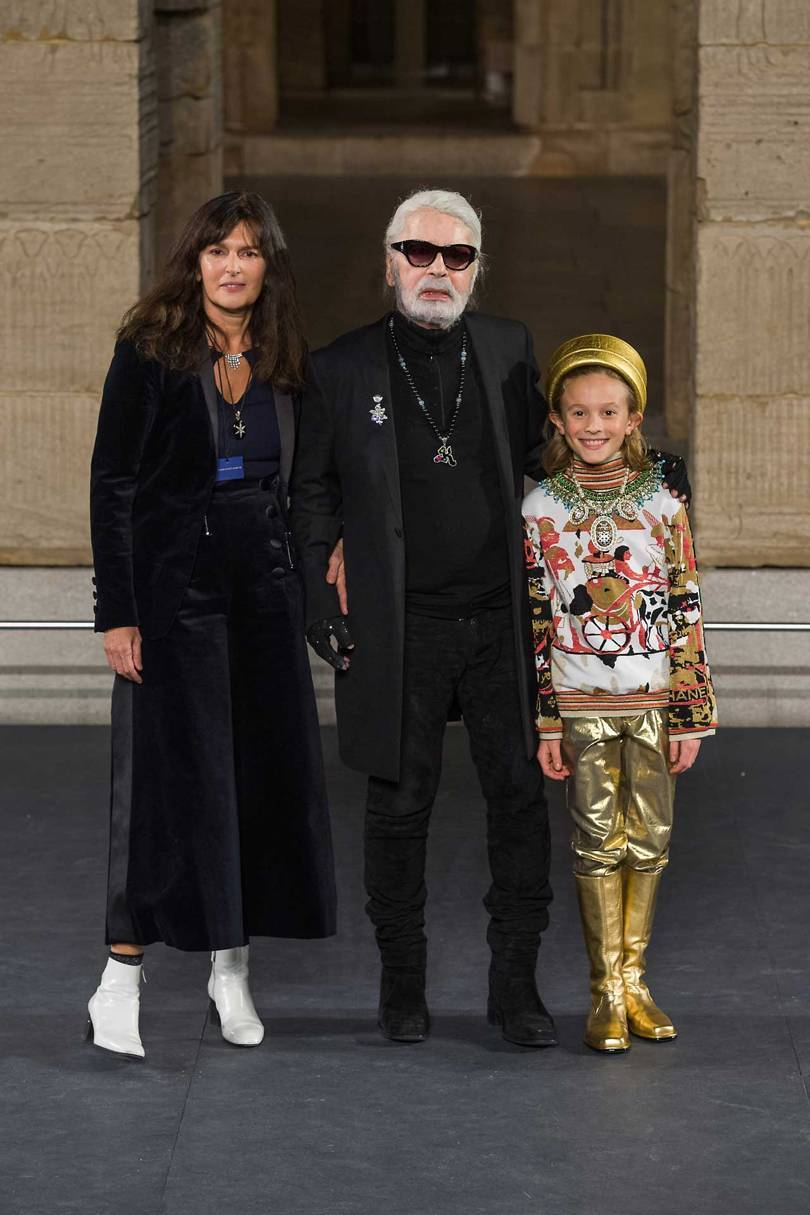 Karl Lagerfeld at the finale of his Pre-Fall collection for Chanel, with Virginie Viard – his head of studio – and his godson Hudson Kroenig. Credit: GORUNWAY