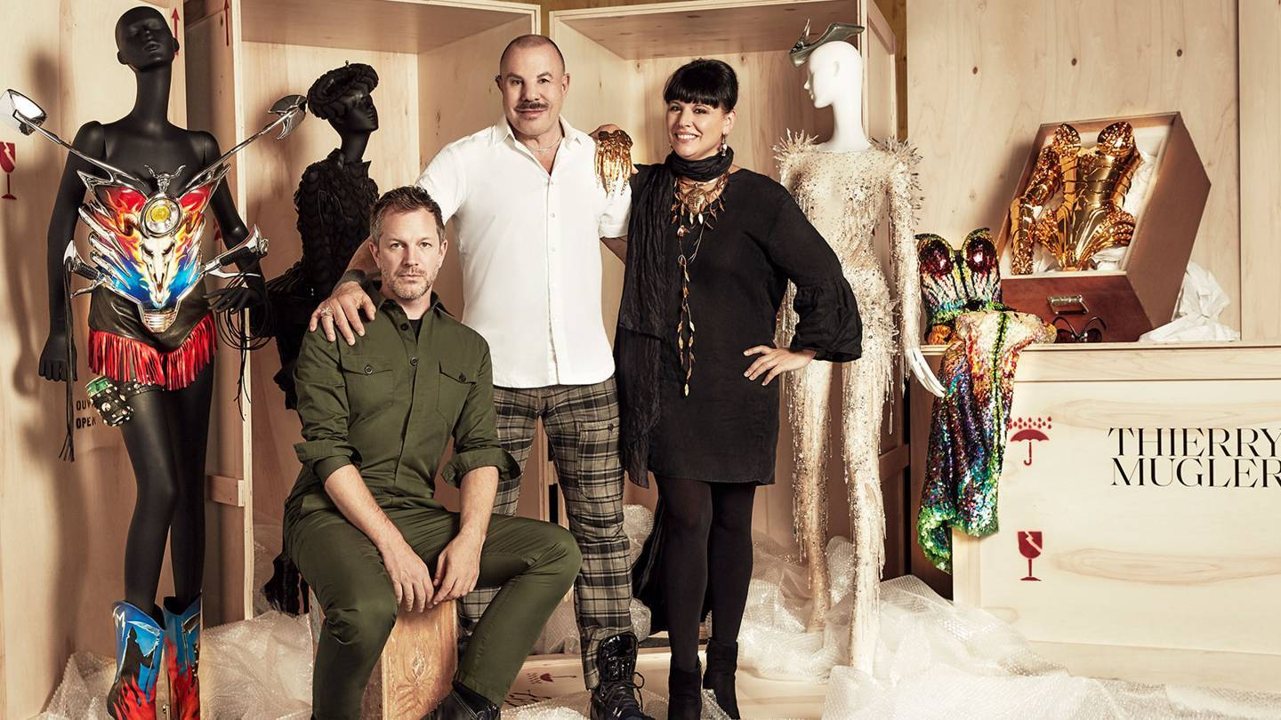 From left, award-winning curator Thierry-Maxime Loriot with creator Manfred Thierry Mugler and Nathalie Bondil, Director General and Chief Curator of the Montreal Museum of Fine Arts behind the scenes of their new exhibition, Thierry Mugler: Couturissime