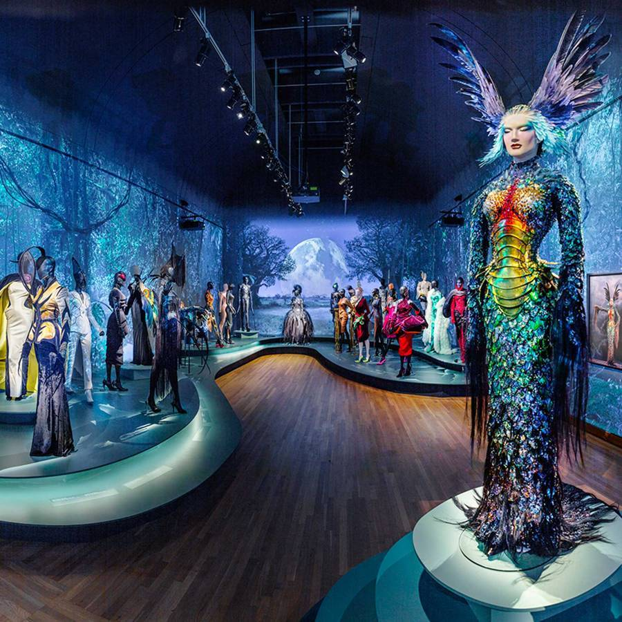"An installation at the exhibition, Thierry Mugler: Couturissime at the Montreal Museum of Fine Arts, 2019. The mannequin on the right showcases Thierry Muglers ""La Chimère"" gown, from the La Chimère collection, Haute Couture Autumn/Winter 1997–1998. Credit: MMFA"