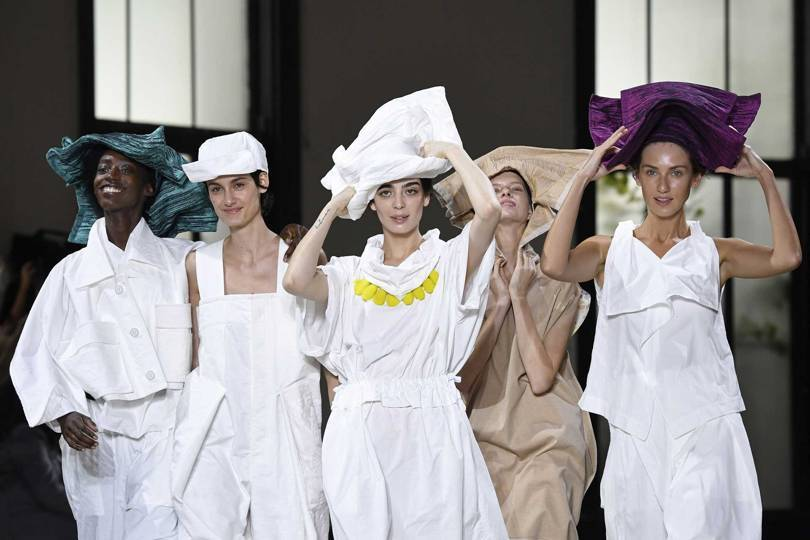 At Issey Miyake Spring/Summer 2019, Creative Director Yoshiyuki Miyamae launched a new technical material – Dough Dough – that can be folded and twisted into shape, as shown here on hats and headpieces. Credit: GETTY