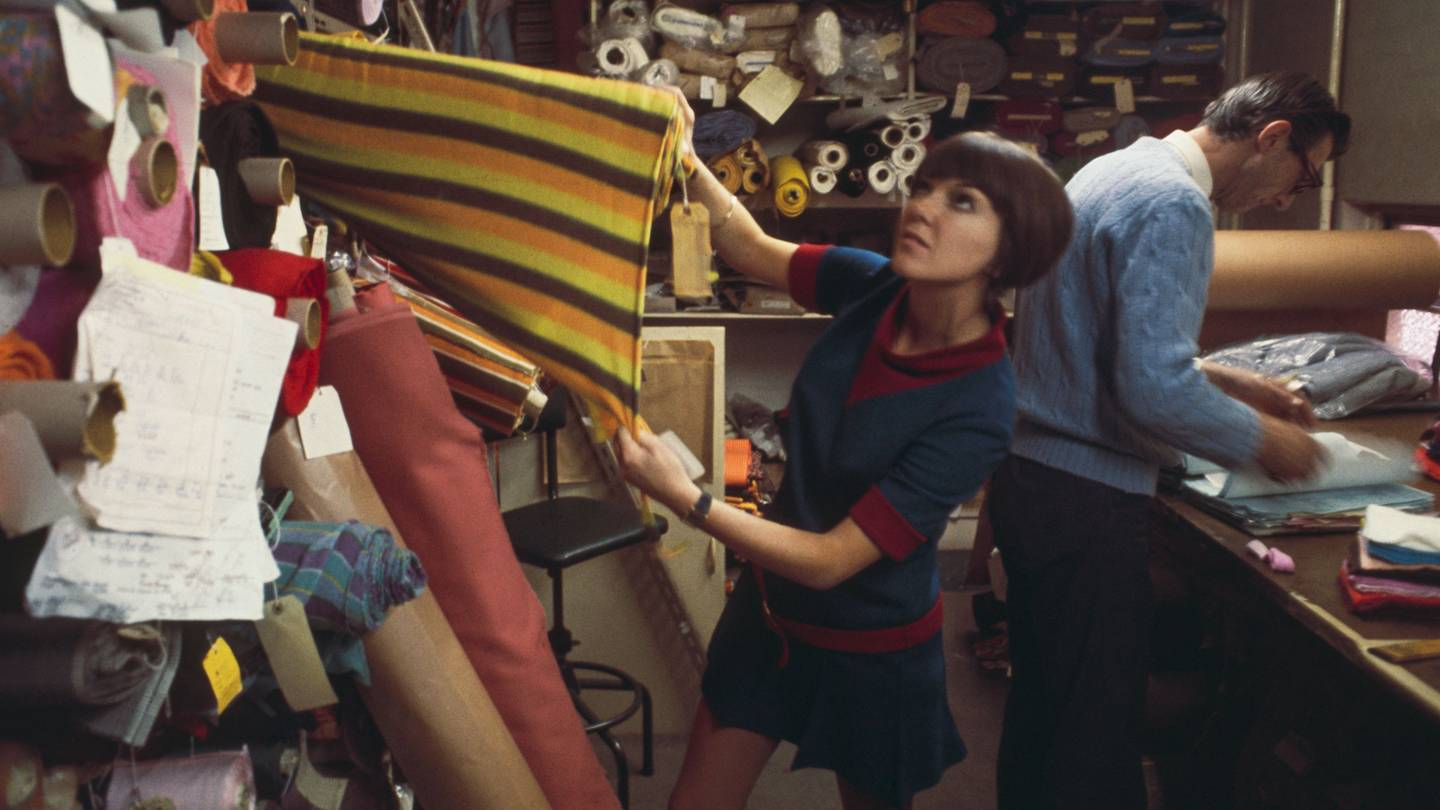 Mary Quant selecting fabric in London in 1967 Credit: ROLLS PRESS / POPPERFOTO / GETTY IMAGES