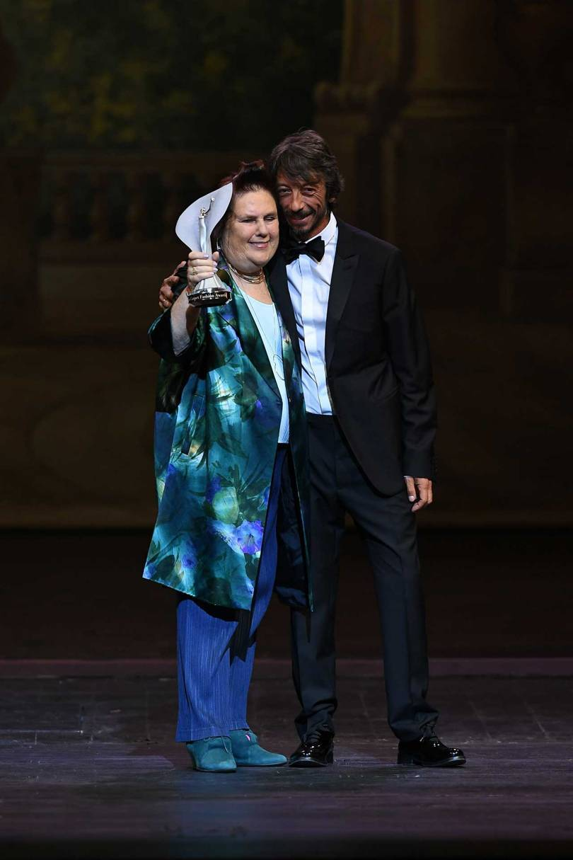 Pierpaolo Piccioli, Creative Director of Valentino, presents Suzy Menkes with the Visionary Award from the Green Carpet Fashion Awards 2018, held in Milan
