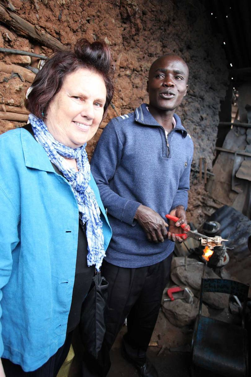 Suzy visits welder Steven Adawo Kine in at his workshop in Kibera, on the outskirts of Nairobi. Adawo-Kine forged Vivienne Westwoods trademark orbs Credit: @SUZYMENKESVOGUE