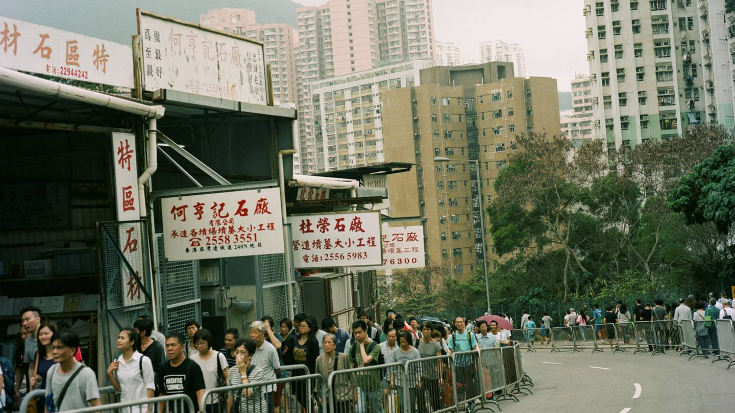 The invitation for Simone Rochas Spring/Summer 2019 show featured a recent Hong Kong cityscape captured by Rochas husband, Eoin McLoughlin, on a research trip during the Ching Ming (or Qingming) Festival, Credits: EOIN MCLOUGHLIN / COURTESY OF SIMONE ROCHA